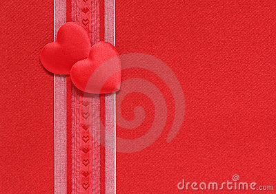 Valentine hearts and ribbon on a red background