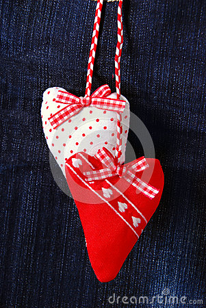 Valentine`s card with hearts on denim background