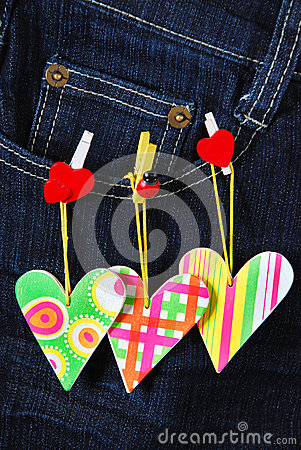 Valentine`s card with hearts on denim pocket