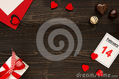 Valentine`s day background with copy space. Valentine`s Day card, gift box and chocolate on the wooden table. Stock Photo
