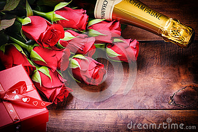 Valentine s setting with red roses, champagne and gift