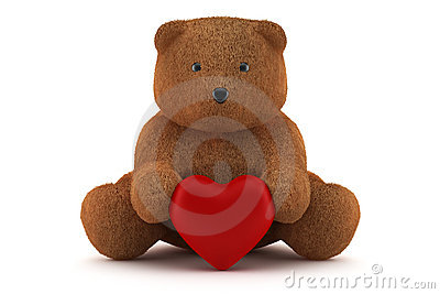 Valentine teddy bear holding a heart isolated