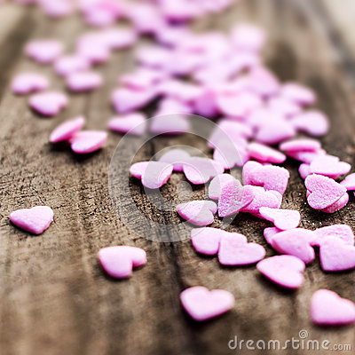 Valentines Day background with hearts. Sugar Hearts on wooden vi