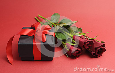 Valentines Day black box with red ribbon gift and red rose