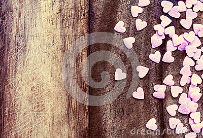 Valentines Day Love concept. Sugar Hearts on wooden vintage text