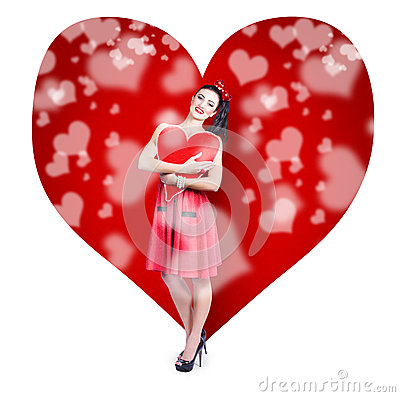 Valentines day woman holding love heart card