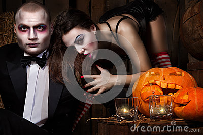 Vampires with halloween pumpkin