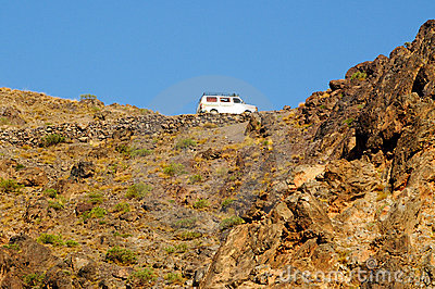 Van driving on high mountain road