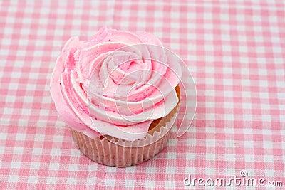 Vanilla cupcake with pink rose icing