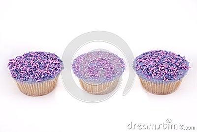 Vanilla cupcakes, with purple-coloured buttercream