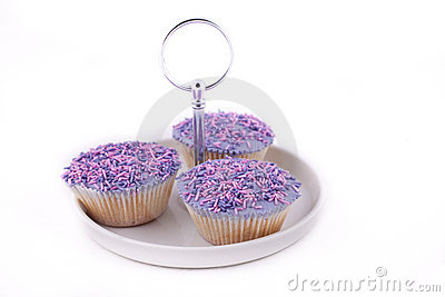 Vanilla cupcakes, with purple-coloured buttercream