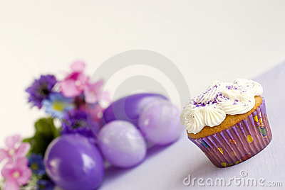 Vanilla Easter Cupcake with purple sprinkles
