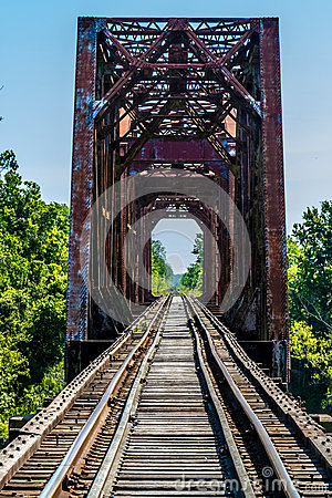 Free Vanishing Point View Of An Old Railroad Trestle With An Old Iron Truss Bridge Over The Brazos River Stock Image - 53314351