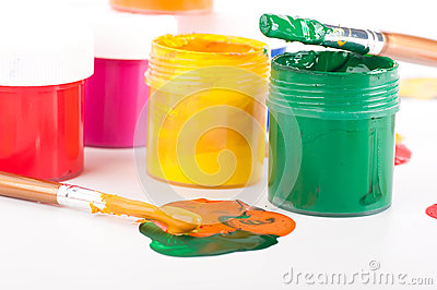 Varicoloured paints and brushes