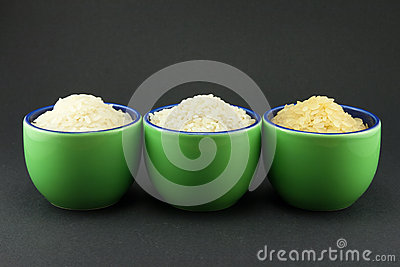 Varieties of rice in three small green cups