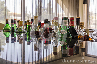 Variety of alcoholic drinks in a bar