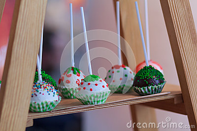 Variety of cakes on a wooden stand Stock Photo