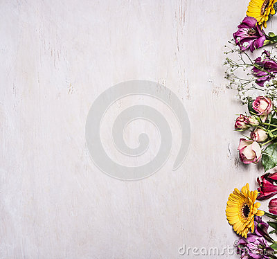 Free Variety Of Spring Flowers, Yellow Roses, The Shrub Roses, Freesia, Sunflowers , Border ,place For Text  On Wooden Rustic Backgroun Royalty Free Stock Photo - 68277225