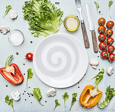 Free Variety Of Vegetables Laid Out Around A White Plate With Oilknife And Fork Wooden Rustic Background Top View Close Up Stock Photos - 65293183