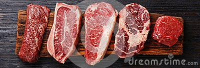 Variety of Raw Black Angus Prime meat steaks Stock Photo