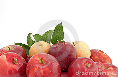 Variety of red and yellow apples with leaves