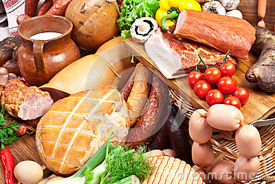 Variety of sausage products with vegetables. Stock Photo