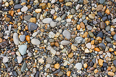 A variety of smooth stones on beach