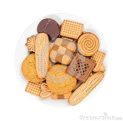 Variety of sweet cookies on a plate on white background, top view Stock Photo