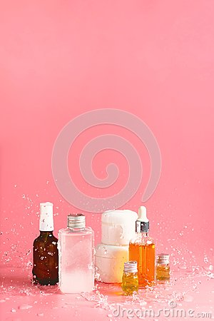 Free Various Bottles, Jars And Containers With Cosmetics On Pink With Splashing Waters. Stock Photo - 110351900