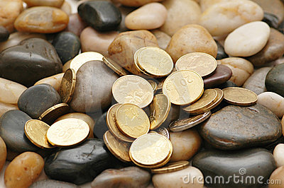 Various coins and pebbles