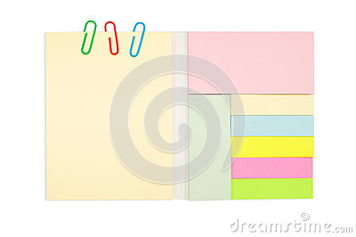 Various color note pad and paper clip isolated on