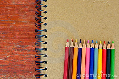 Various color pencils and note book