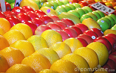 Various colorful fresh fruits on market stand