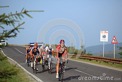 Various cyclists climbing on the road to Paltinis, Romania. Editorial Photography