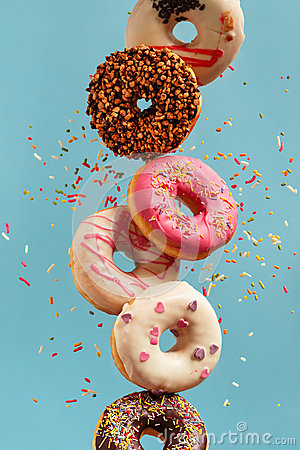 Free Various Decorated Doughnuts In Motion Falling On Blue Background Royalty Free Stock Photography - 90155527