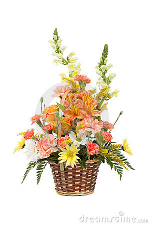 Various flowers in basket on white