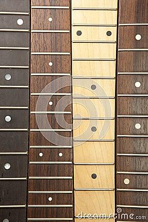 Various guitar necks aligned,
