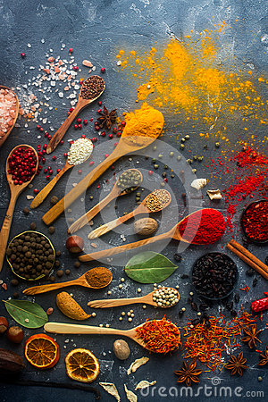 Free Various Indian Spices In Wooden And Silver Spoons And Metal Bowls, Seeds, Herbs And Nuts On Dark Stone Table Royalty Free Stock Photography - 95836877