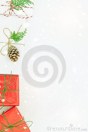 Free Various Kinds Of Gift Boxes Wrapped In Red White Paper Tied With Twine Green Ribbon Pine Cone Juniper. Falling Snow. Christmas Royalty Free Stock Photo - 129939155