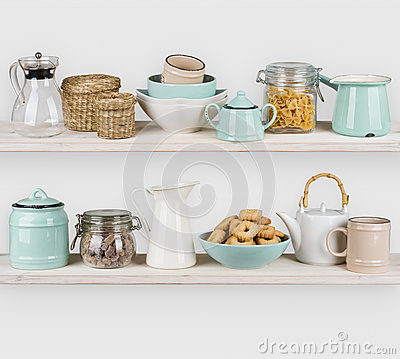Free Various Kitchen Utensils And Food Ingredients Isolated On Wooden Shelves Stock Image - 79527771