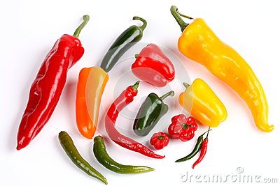 Various peppers on white