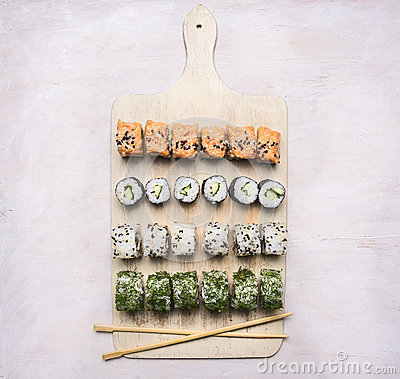 Free Various Sushi Sets, Dill, Salmon, Crab On A White Cutting Board  Asian Food On Wooden Rustic Background Top View Close Up Royalty Free Stock Photos - 73899708