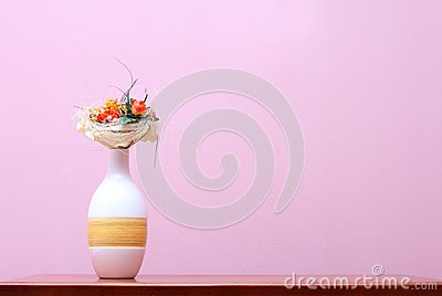 Vase against purple wall