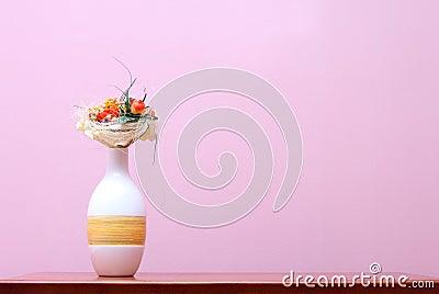 Vase against purple wall