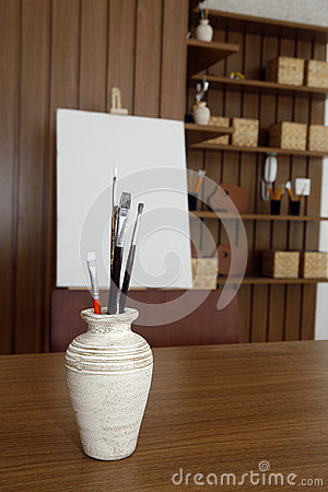 vase with brushes