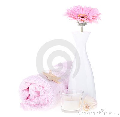 Vase with pink flower and towel