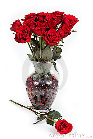 Vase of red roses.