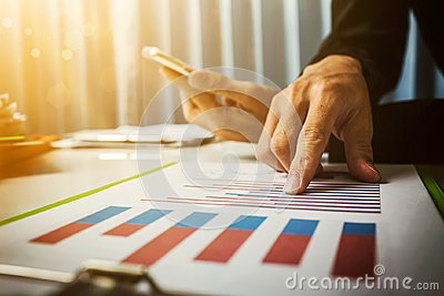 Vat and loan rates calculated by the bank of according to the tax code of the government. Business man asian hard working in the o Stock Photo