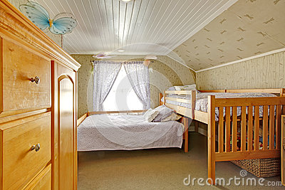 Vaulted ceiling bedroom with low and high beds