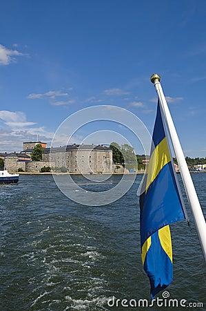 Vaxholm fortress and Swedish flag